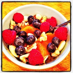 Overnight oats, berries, nuts, persimmon